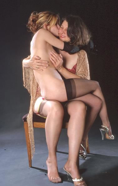 nude girl sits foreward on lap pics